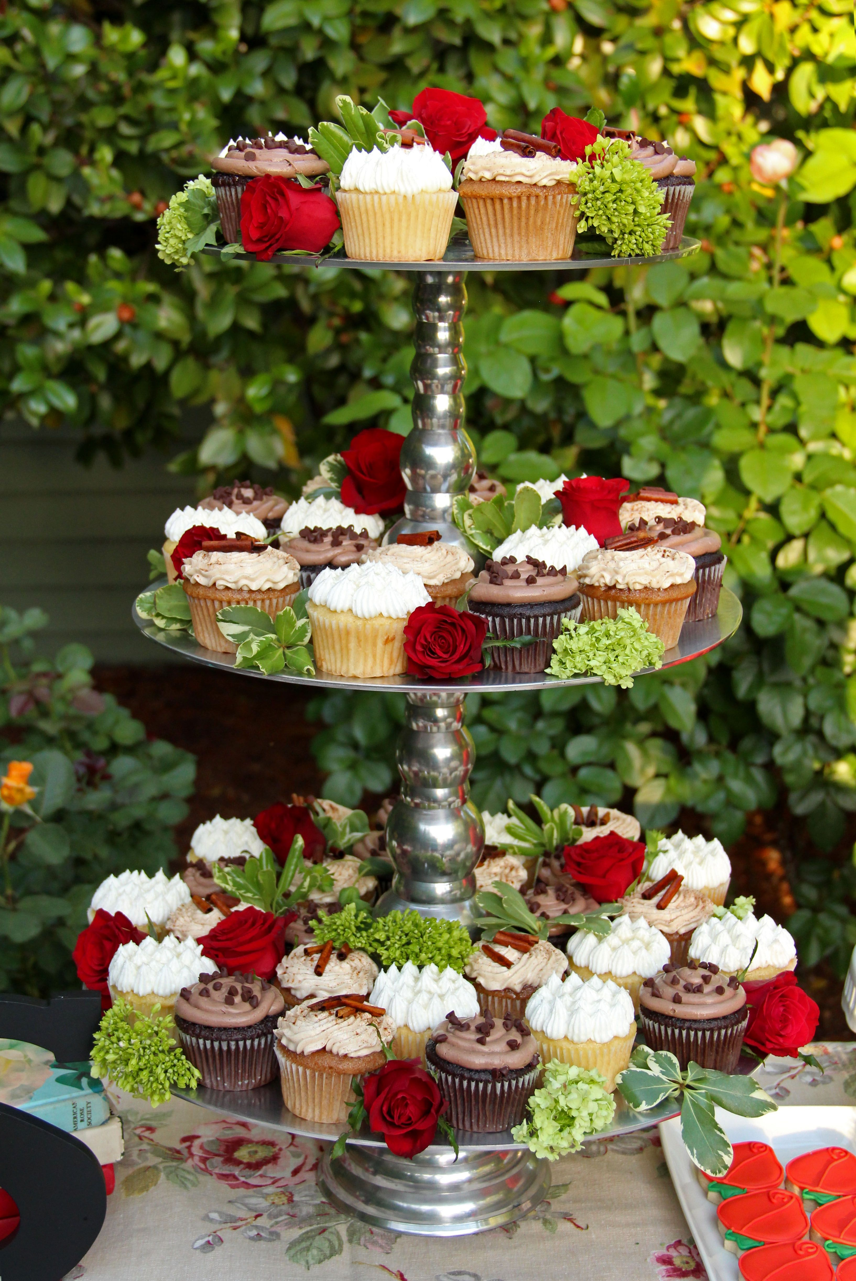 This is the cupcake tower we will be using. The chocolate cake should be on top. There will be flowers between the cupcakes.