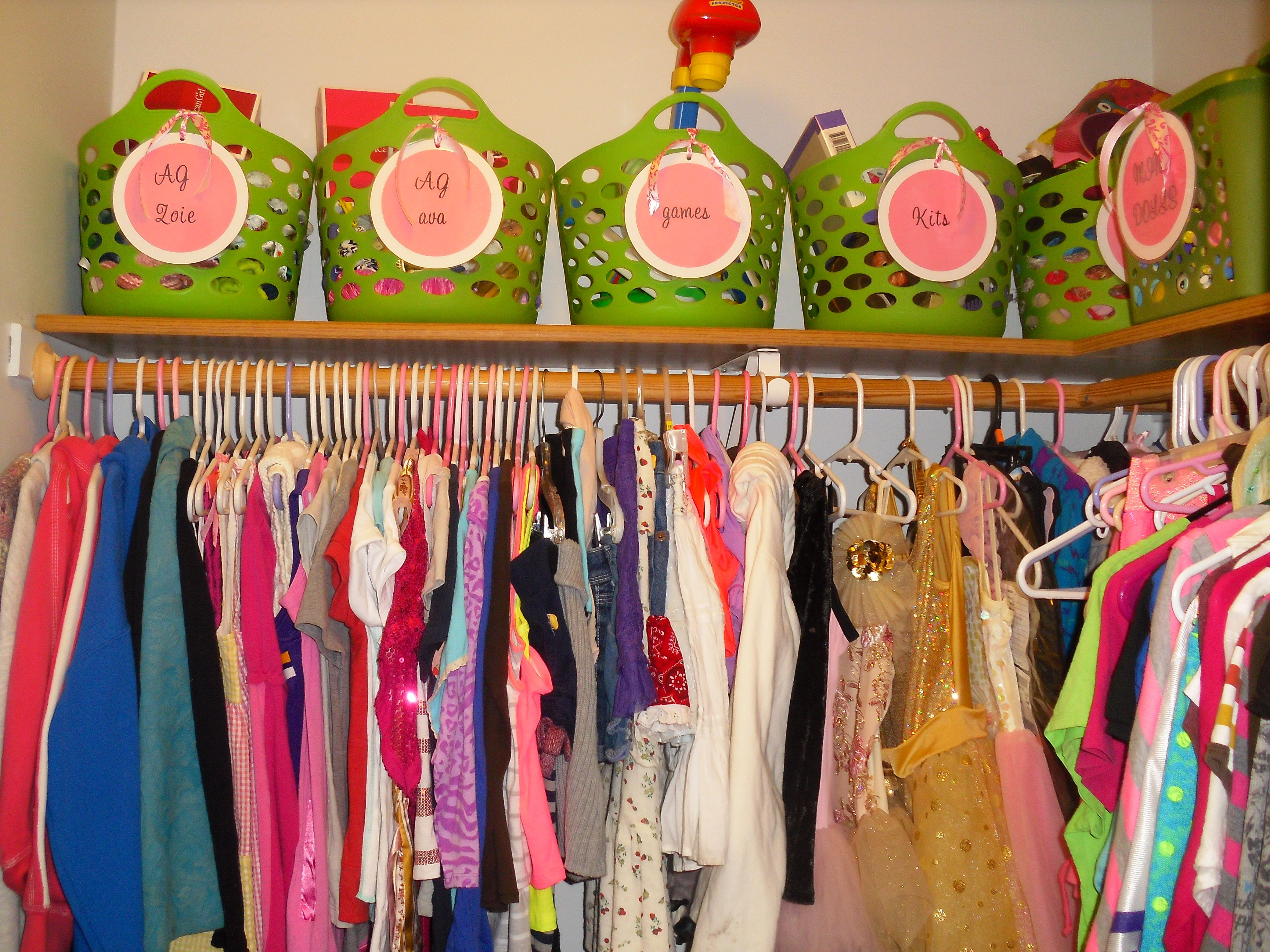 organize girls closet with baskets from dollar tree and make your own tags with cardstock