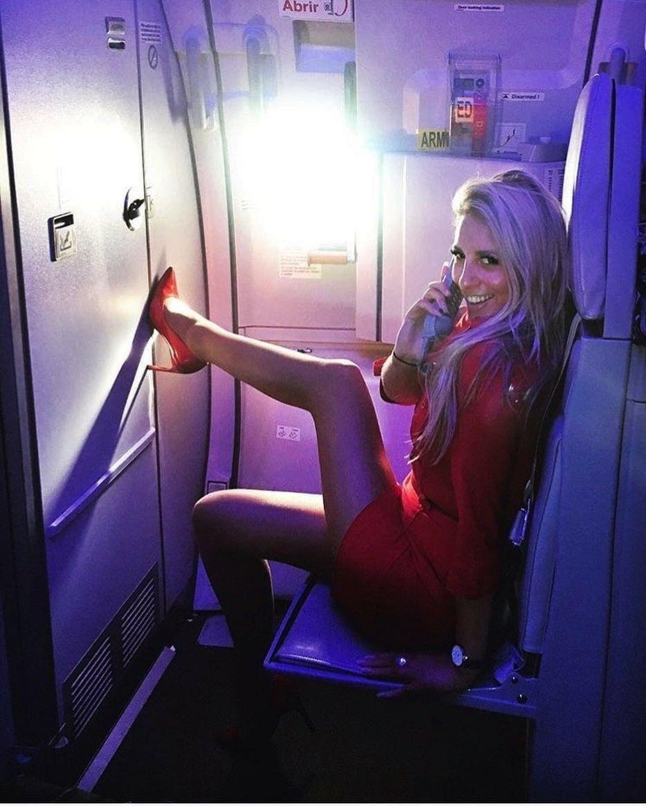 Portrait smiling, confident female flight attendant on
