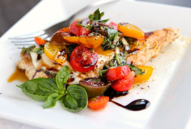 Enjoy the flavors of summer with this Caprese Grilled Chicken, topped with creamy mozzarella, cool tomatoes, and lots of fresh basil!