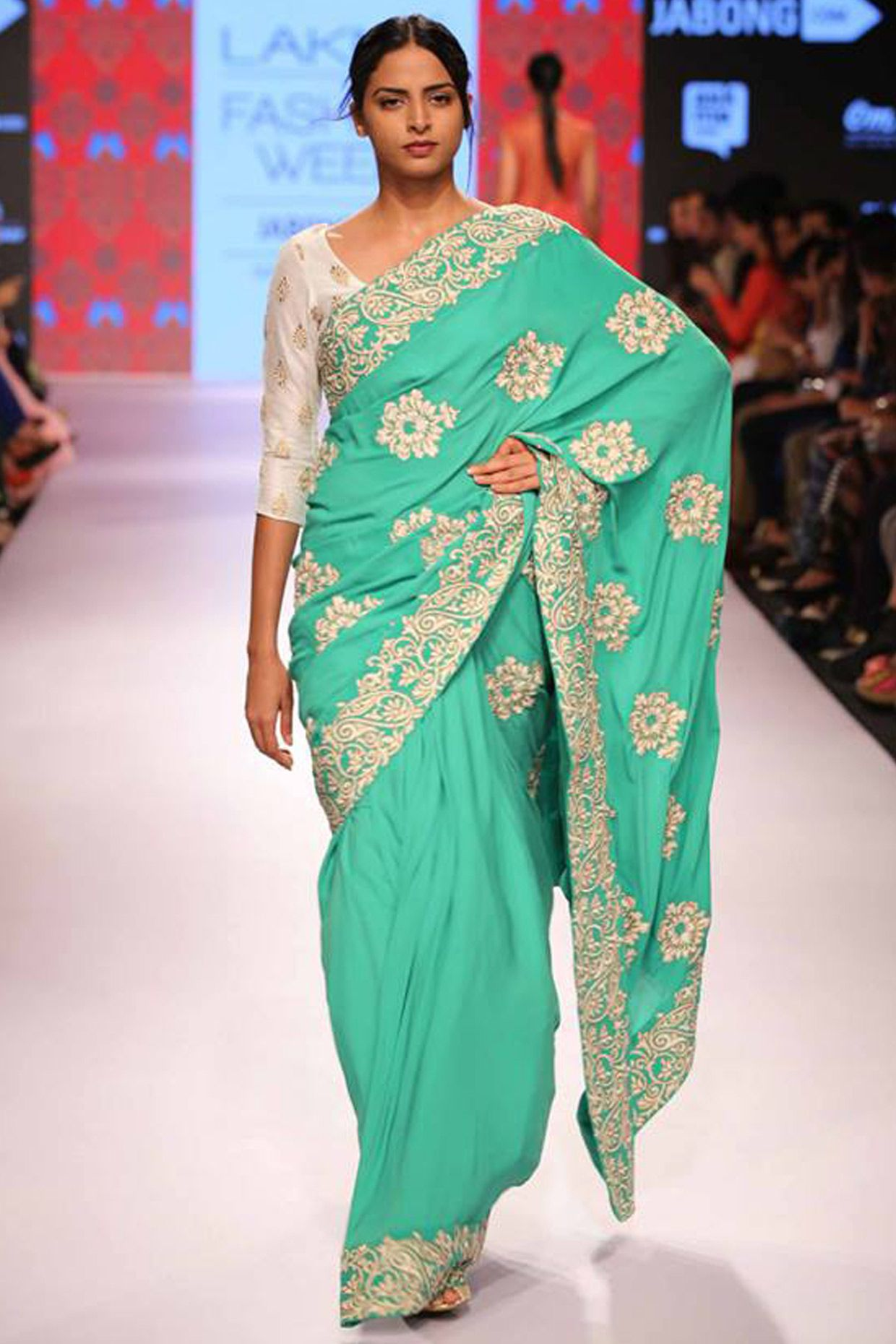 Green embroidered sari with white net blouse available only at