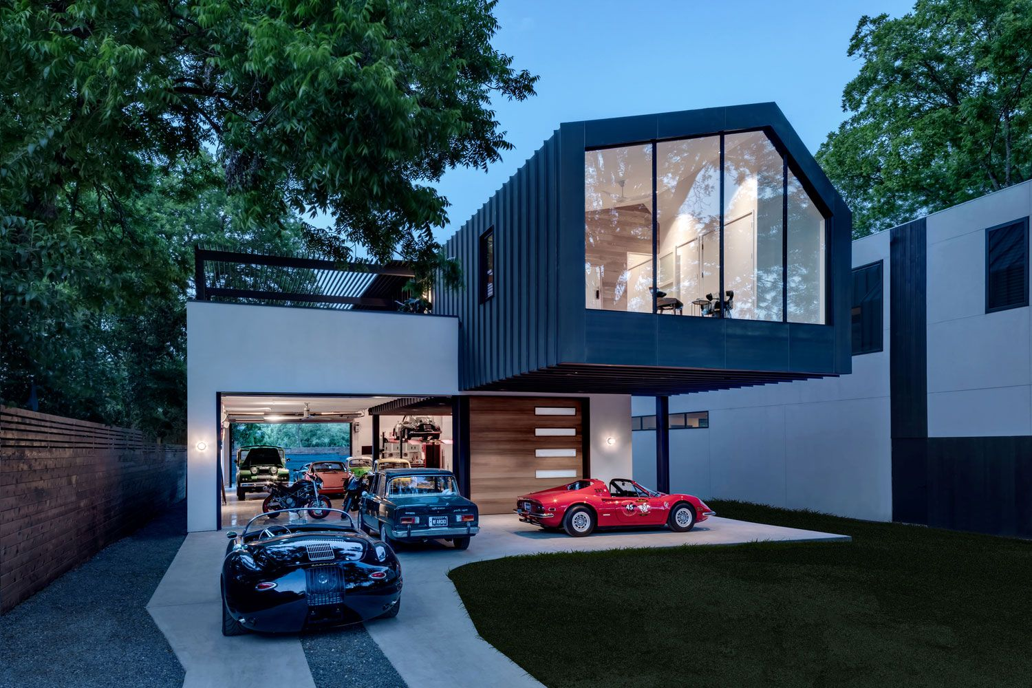 Modern And Functional House Which Doubles As A Car Collector S Garage And Private Residence Austin Homes Garage Design Modern House Design