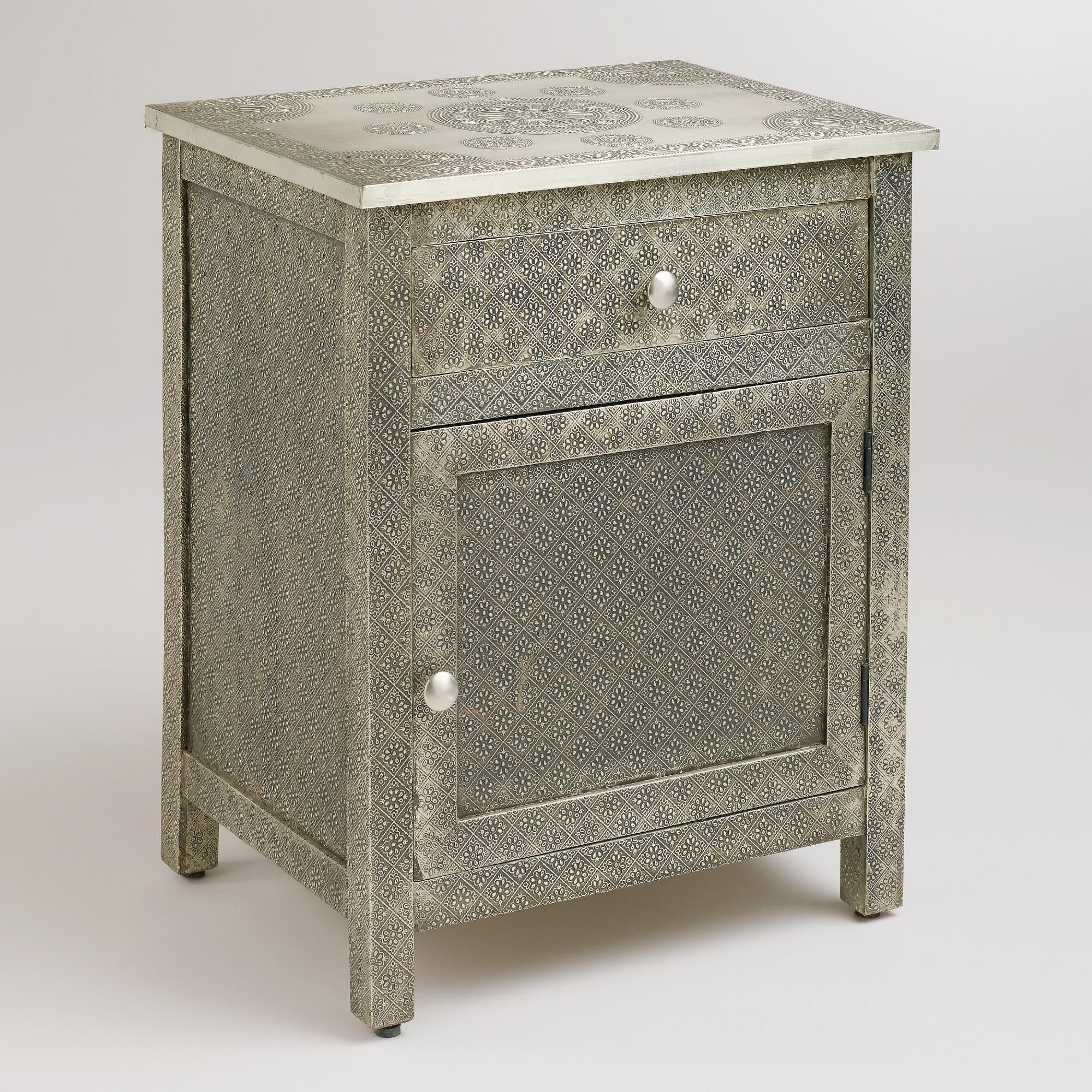 Crafted of mango wood wrapped in hand embossed metal our kiran embossed metal cabinet is rich with character and versatility featuring a medallion motif