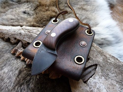 Walnut cracker safe keeping. Based loosely on the idea of a patch knife sheath this rustic tip down neck carry sheath was wet formed from 4mm thick veg tan leather