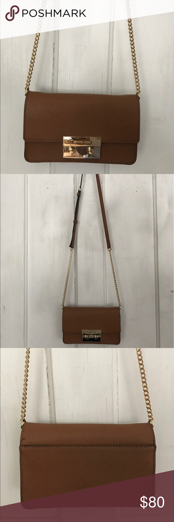 Michael Kors crossbody bag Gently used. No damage. Inside has three compartments along with a main zippered part and pockets for credit cards along the back. Interior has MK signature design allover. Michael Kors Bags