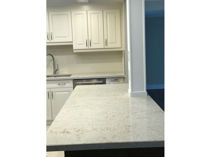 Quartz kitchen island with custom kitchen cabinets in white solid quartz kitchen island with custom kitchen cabinets in white workwithnaturefo