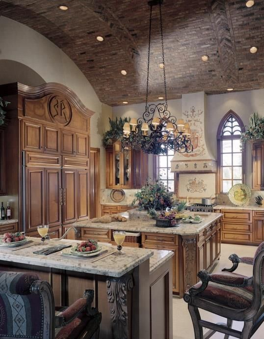 """OMG ~ What a magnificent kitchen with Old World charm!  Love the brick barrel ceiling, the windows, the massive island, and the beautiful chandelier.  Would love to have a double refrigerator like this one!  From the Facebook community """"Brambleberry Cottage""""."""