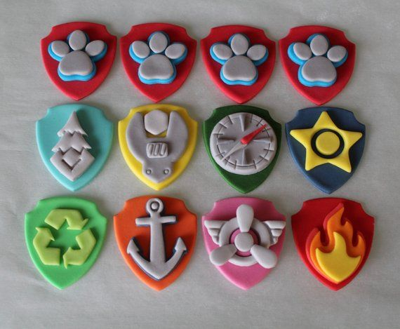 12 Paw Patrol Badge Fondant Cupcake Toppers - Paw patrol cake toppers, Paw patrol cupcake toppers, Paw patrol cookies, Paw patrol cupcakes, Paw patrol cake, Fondant cupcake toppers - Each topper set of 12 will include 4Ryder (Paw Prints) 1Marshall (Fire) 1Chase (Star) 1Rocky (Recycling) 1Zuma (Anchor) 1Rubble (Wrench) 1Skye (Propeller) 1Everest (Tree) 1Tracker (Compass) Cupcakes not included  If selecting a topper set of 9, set will include the above listed characters, minus 3 Ryder Paw Prints  Please allow 12 weeks for your toppers to be made, dried, and ready to ship  Toppers are shipped once they are dried and can be stored in an airtight container until your event  Do NOT place toppers in the refrigerator or the freezer   Toppers can lose their shape if placed on iced cupcakes for an extended period of time  Be sure to place the toppers on the cupcakes just prior to the event  Toppers are designed to fit standard size cupcakes and measure about 2 inches in height  Please contact me with any questions regarding your order  Thanks for shopping!