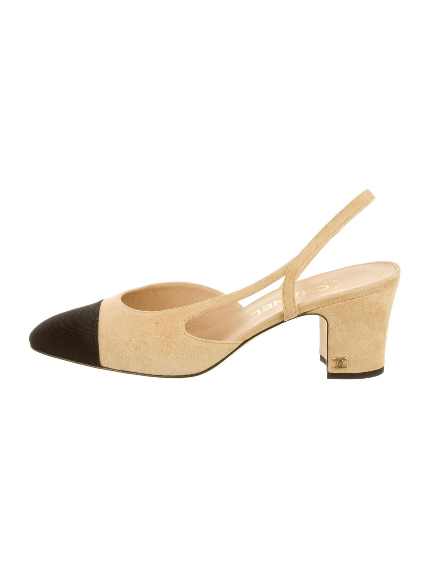8b39261c17598 Tan suede Chanel round-toe slingback pumps with black cap toes, tonal  stitching throughout and gold-tone CC at covered block heels.