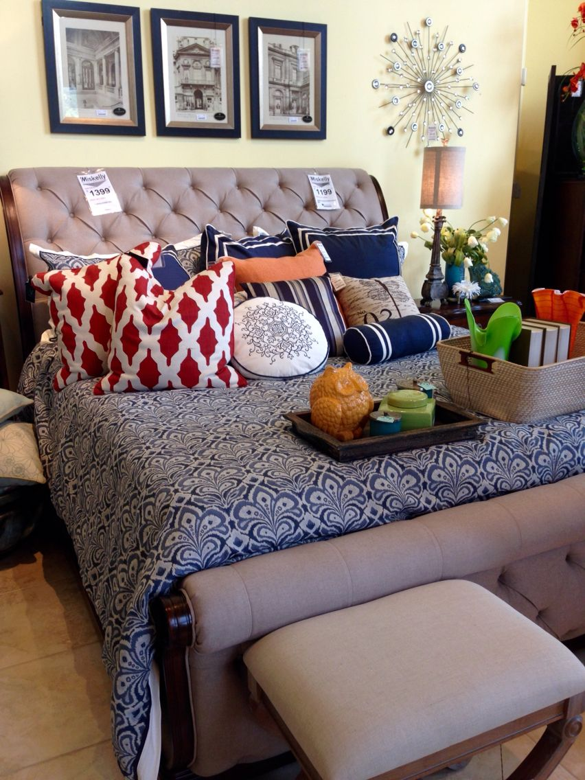 Tan upholstered sleigh bed. Beautiful!