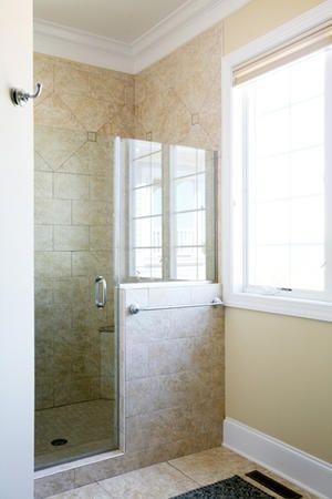 walkin shower with half wall shower door and half glass wall