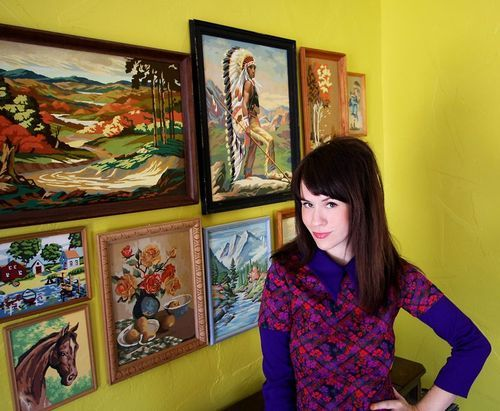 those tacky, colorful, retro paintings and yellow walls speak to the weird 60's part of me.