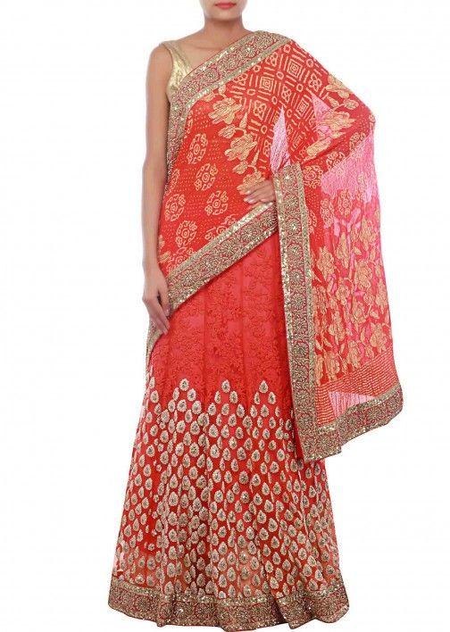 Orange lehenga saree embellished in thread and zari embroidery only on Kalki