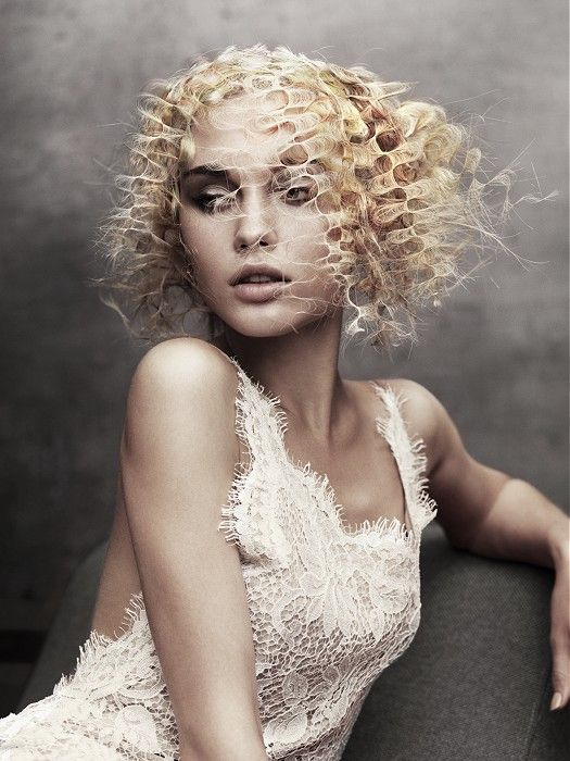 Large image of medium blonde curly hairstyles provided by Angelo Seminara. Picture Number 19757
