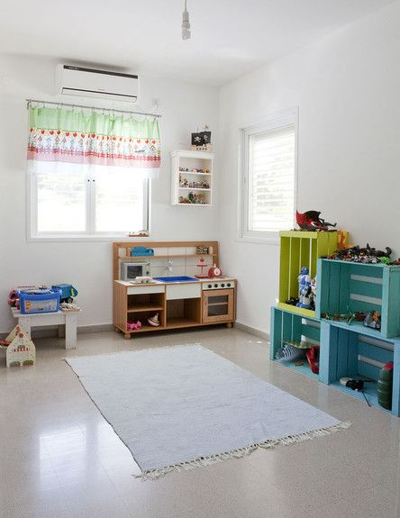 Kids play room...like the wooden crate shelves
