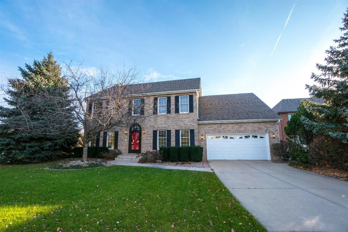 This Munster TWO-STORY boasts one of the BIGGEST YARDS in town ...