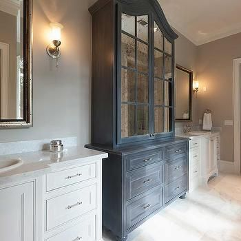 dark gray distressed bathroom linen cabinet with antiqued