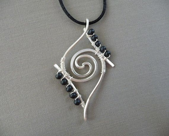 Pretty wire wrapped silver pendant necklace with black beads. Unique ...