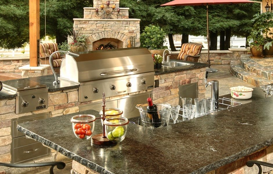 Custom Outdoor Kitchen With Dark Granite Counter Tops A Fireplace And A Kegerator Outdoor Kitchen Outdoor Kitchen Countertops Outdoor Kitchen Plans