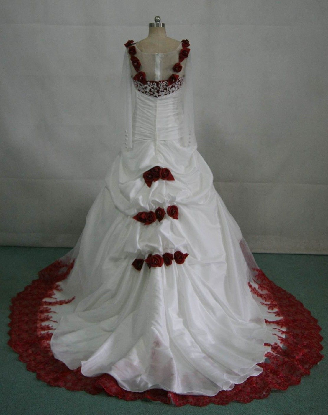 White Wedding Gown With Red Roses On The Dress
