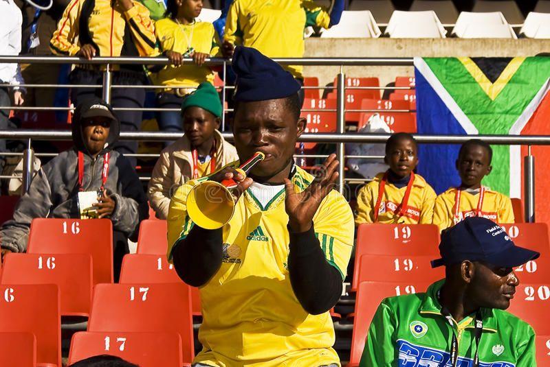 Soccer Fan Blows On Vuvuzela Horn South African Soccer Fan Blowing His Vuvuzela Aff Soccer African Fan Vuvuzela Soccer Fans Soccer Graphic Design Layouts