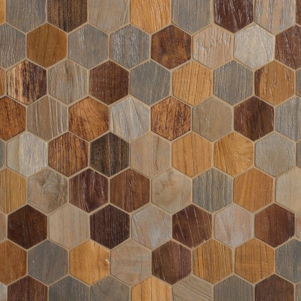 """AnTeak"" wood mosaic tile, from Walker Zanger. Comes in hexagon, herringbone and chevron shapes, and different colors! ""The wood is taken from buildings being taken down for new construction,"" said Jared Becker, vice president of design and marketing for Walker Zanger. ""They're already cured, because they've been exposed to the elements for 75 or 100 years."" via L.A. at Home"