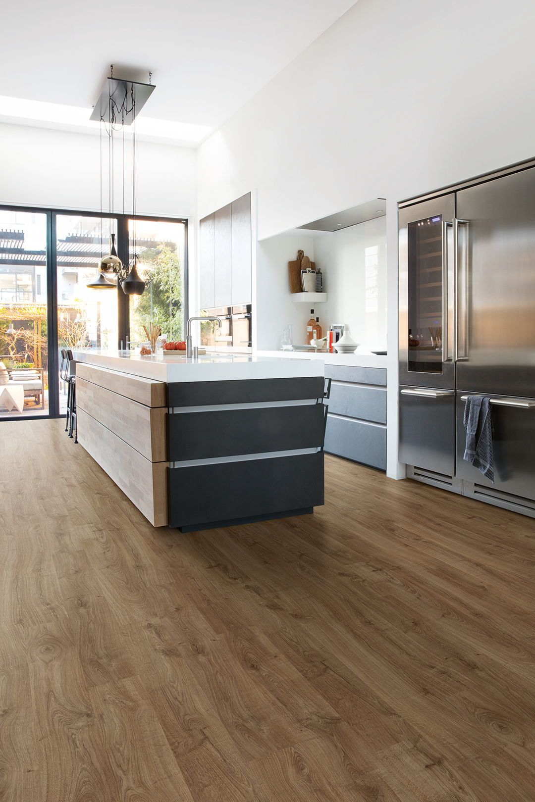 Bring out the best of your modern interior with this brown laminate flooring these dark