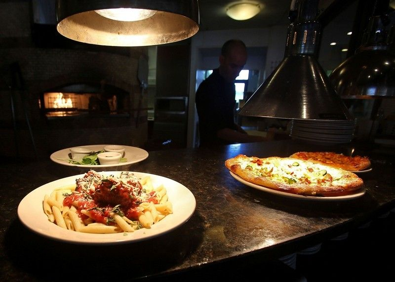 Pasta and salads are on the menu at Finn's Brick Oven in the Belle Hall Shopping Center.