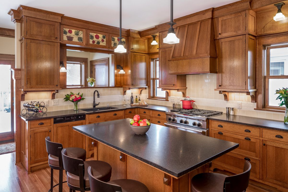 Minneapolis craftsman kitchen remodel by Sicora Design Build.  Modern kitchen with a design that incorporates original 1915 built-in details into new custom-made, quartersawn oak woodwork and cabinets.