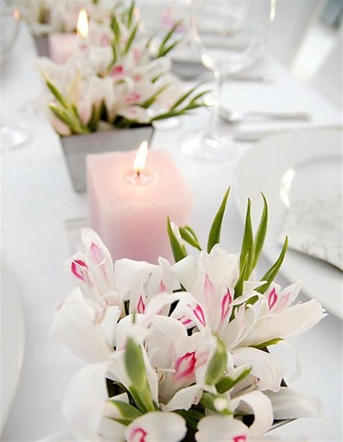 Pink wedding decorations - love the square candles echoing the square vases ♥