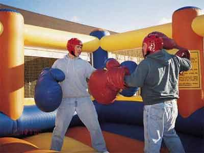 Bouncy Boxing With Giant Oversized Boxing Gloves Backyard Birthday Parties Backyard Birthday Bouncy