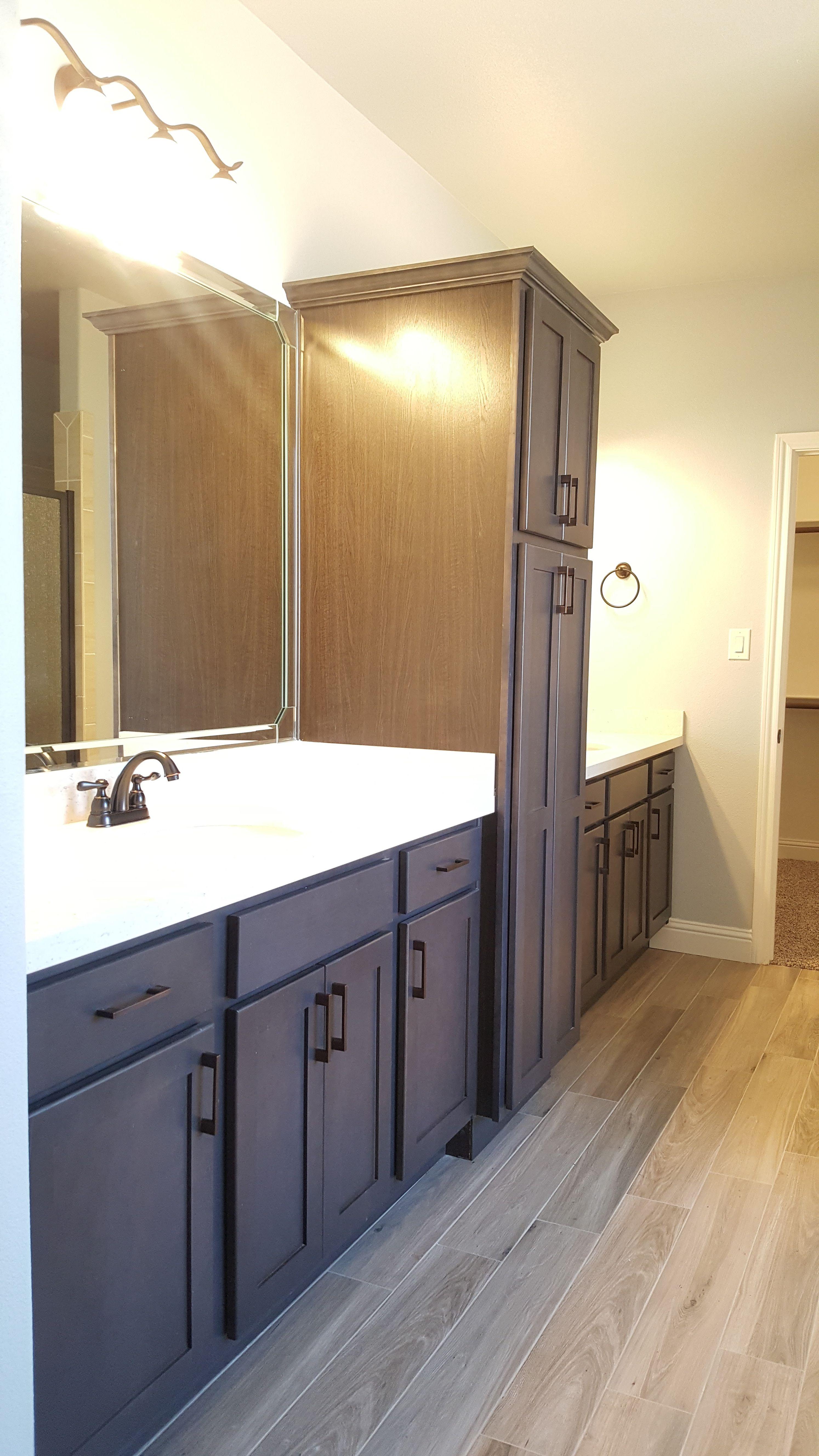 fabiana master bath featuring quartz countertops linen