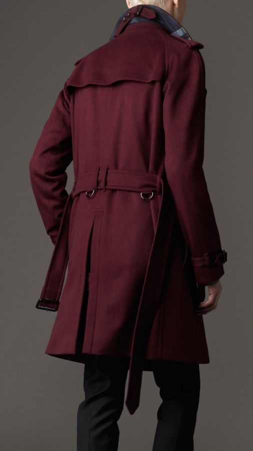 """A maroon trench coat wrapped around his body like a second skin . . ."""