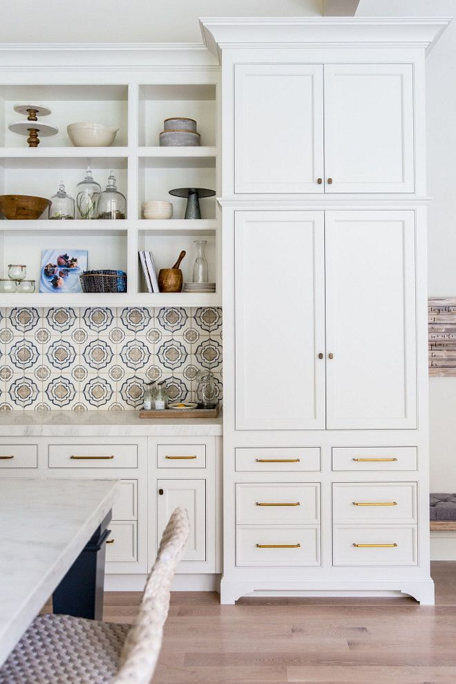 Cabinets feature a custom base. The Accent Tile is from Walker Zanger--Duquesa Jasmine Mezzanotte 4 X 4 #pantrycabinet