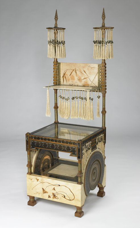 Carlo Bugatti (1856-1940) - Side/Display Table . Carved, Turned & Inlaid Wood, Inlaid Metals, Brass, Painted Vellum, Glass and Silk Tassles. Circa 1900.