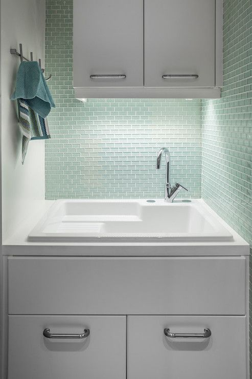 Seafoam green mini subway tile laundry room sink Laundry