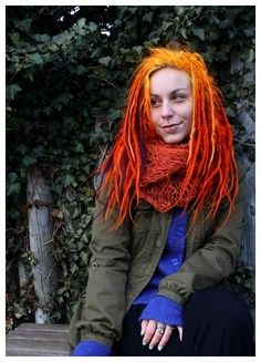 I love how her scarf matches her locs.
