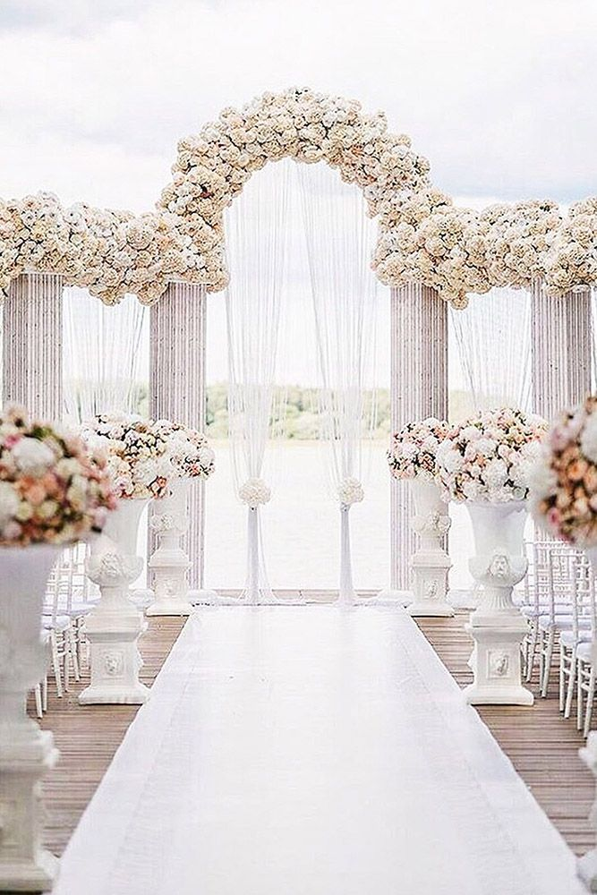 wedding altar decoration white arches are decorated with many
