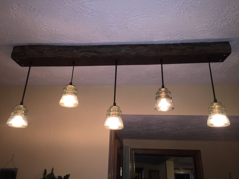 5 Glass Insulator Pendant Lights Hanging On Aged Wood Plank Custom