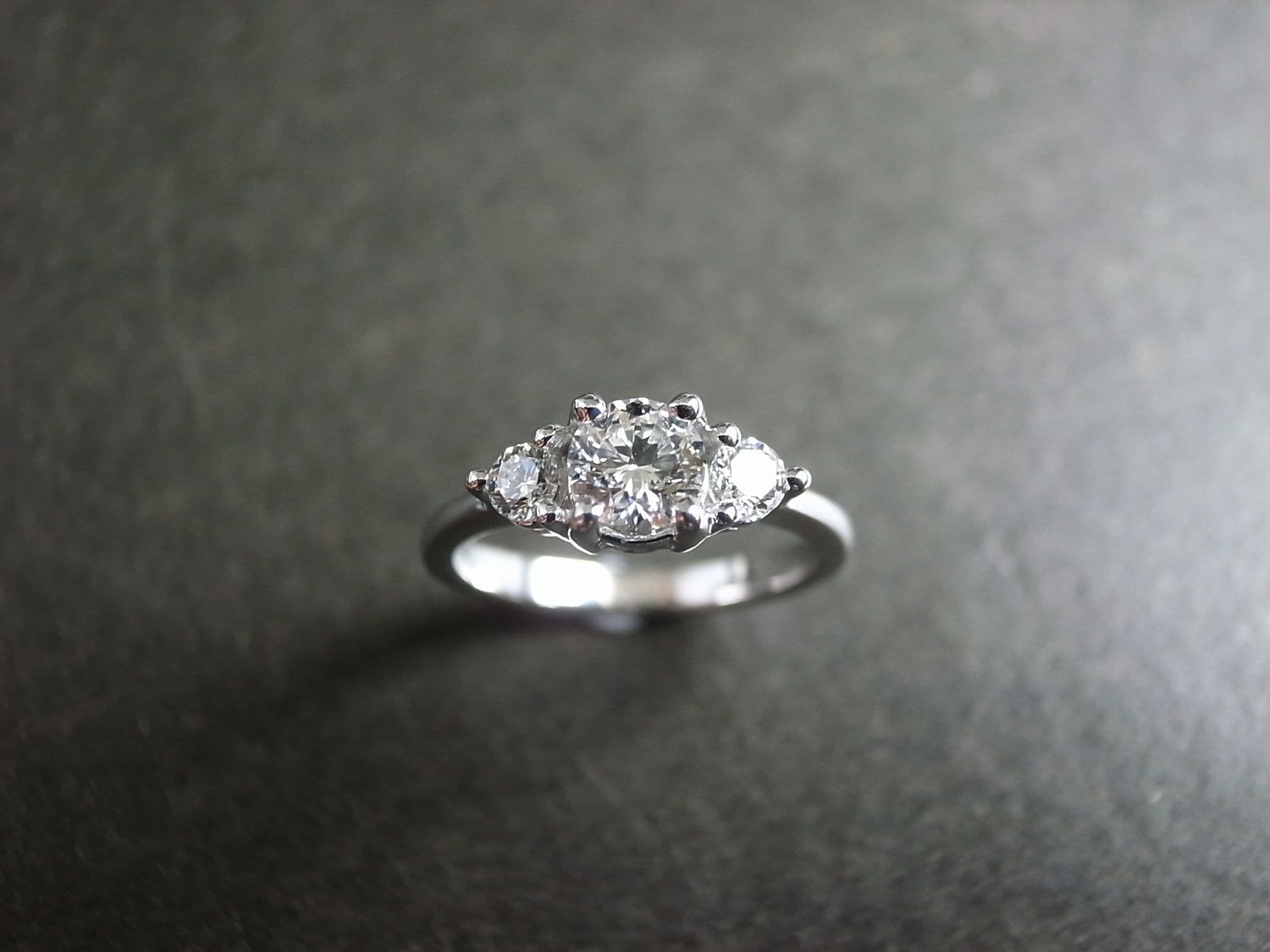 3 band wedding ring 3 stone engagement ring but with diamonds around the band part