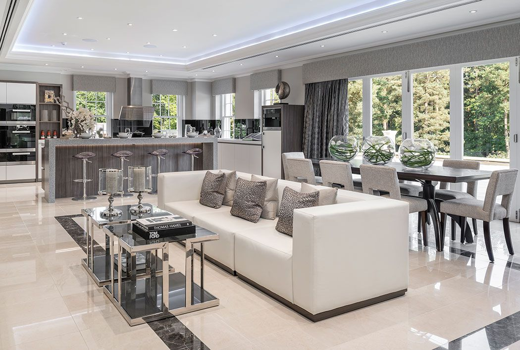 Elegant contemporary kitchen/breakfast/family room in luxurious Surrey mansion in subtle tones ...