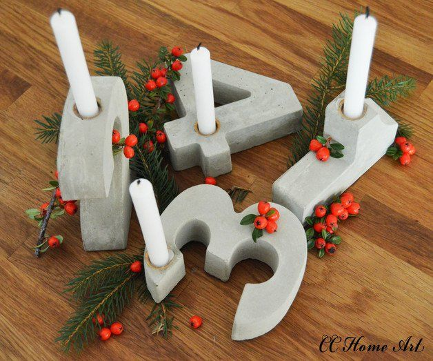 Photo of Candle holder made of concrete as a modern advent wreath for Christmas decorations / mod …