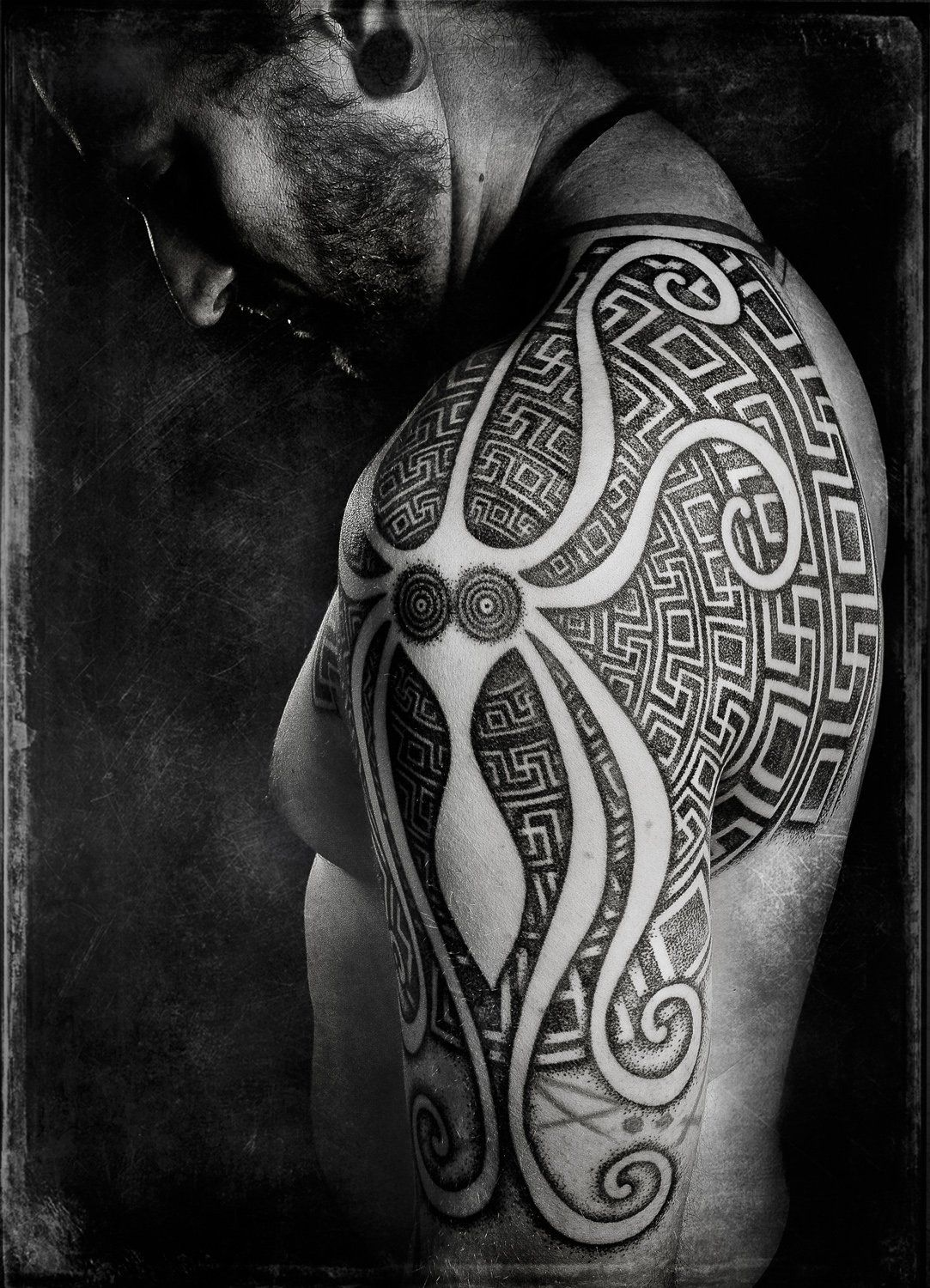 d4d5bed3186cf Negative space octopus in this neo tribal shoulder tattoo by Peter Madsen.