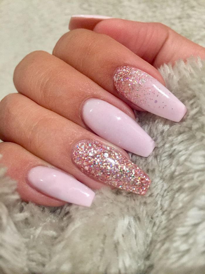 Pale Baby Pink Nail Polish Decorated Wth Pink Iridescent Glitter On A Hand With Long Coffin Nails Grasping Pink Glitter Nails Coffin Shape Nails Squoval Nails