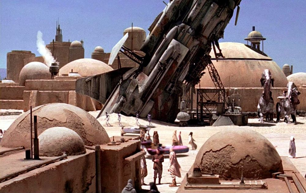 Images From Star Wars Episode Iv A New Hope Wookieepedia The Star Wars Wiki With Images Star Wars Planets Star Wars Episode Iv Mos Eisley