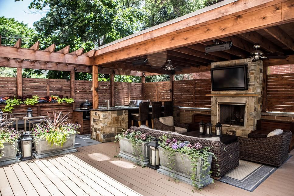 Deck features zones for entertainment cooking relaxing for Outdoor kitchen under pergola