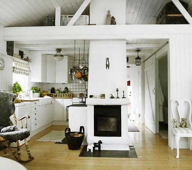 Small Scandinavian Cottage White Planked Walls Valted Beamed Ceilings Really Open Up This Small Cottage Interiors Cottage House Interior Cottage Interiors