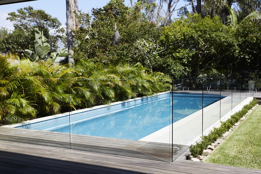 Seamless ground levels and glass pool fencing design for Designer glass pool fencing
