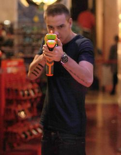 They bought Nerf guns at Toys R Us and shot the paparazzi with them. :) only one direction!