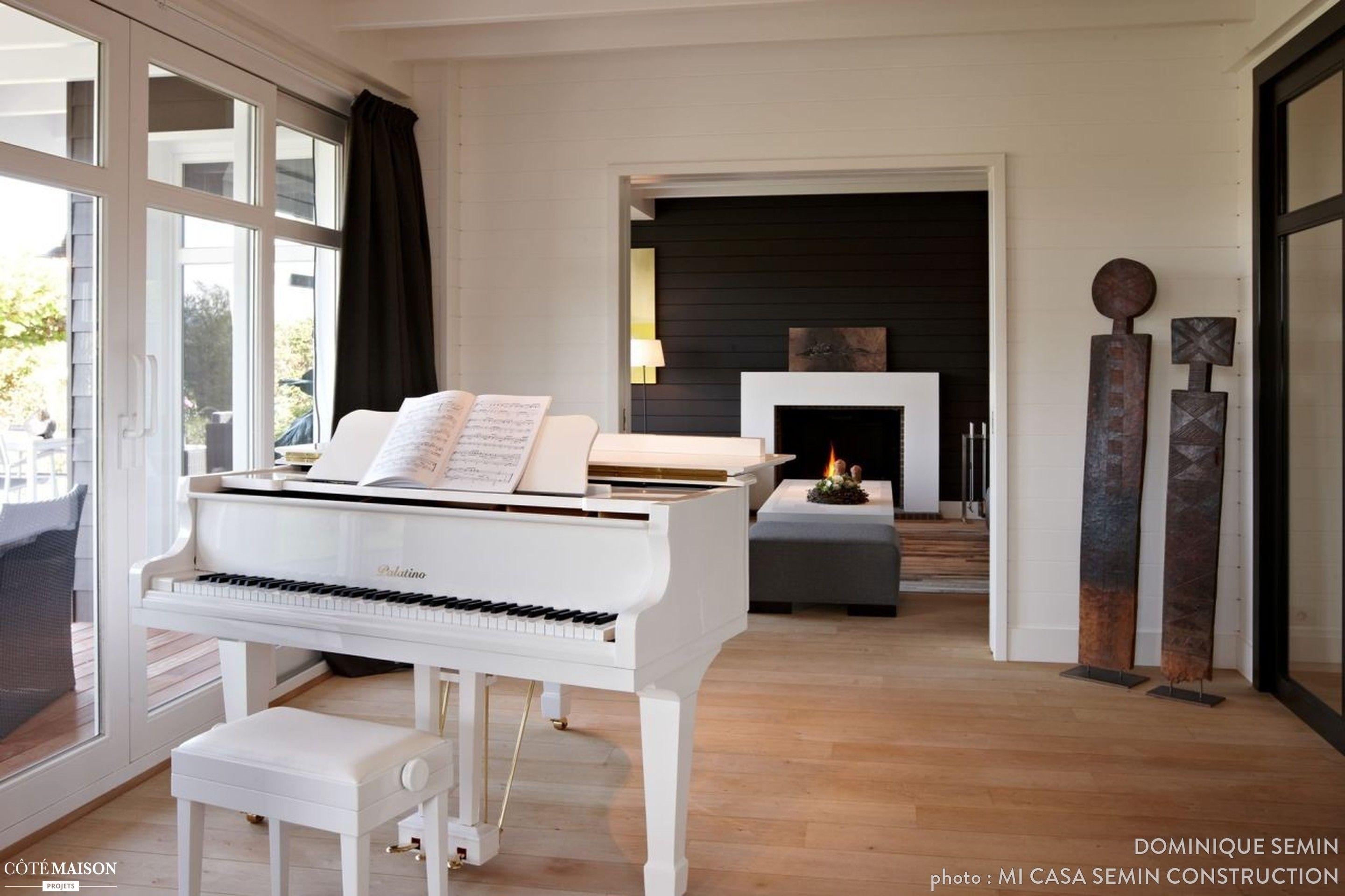 une salle de musique ouverte qui se r chauffe gr ce la chemin e dans l 39 autre pi ce maison. Black Bedroom Furniture Sets. Home Design Ideas